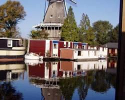 Photo of Houseboat Under The Mill Amsterdam