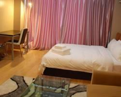 Baoyue Steward Type Service Apartment Hotel Qingdao Beer City Convention Center
