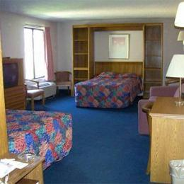 ‪Compare Inn and Suites‬