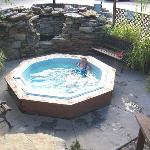  A hot tub a few steps down from the pool offers a quiet space for the adults.