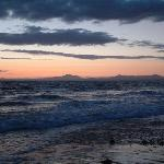 Looking from Harlech Beach toward Criccieth and the Mountains of Snowdonia at Dusk