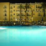 Hotel and pool at lit at night