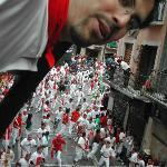 I'm on a balcony above thousands running with the bulls!