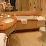 Well equipped bathroom with huge bath