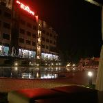a photo of the hotel outdoor swimming pool by night