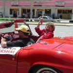 Dale drives Ms Patty Kosier (THE Maggie's daughter)  in the Maggie parade