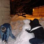 Staff helping me build my first snowman