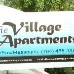The Village Apartment sign.