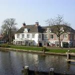 View of the hotel from across the river Vecht