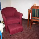 One of two room chairs with roll-out footrest.