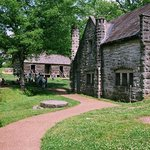 the dairy house with slave quarters in the background