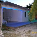 Patio of bungalow at night; yes neon lights