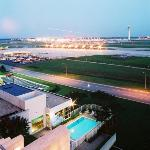 View of outdoor Pool and Hartsfield at dusk