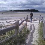 Walking across the sand bar at low tide to reach Little Chebeague Island