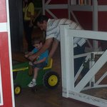 my son rideing the tractors at the science place