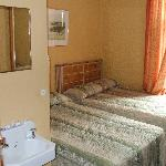 Room pic with sink and beds.  I recommend you not touch the bedspreads!