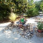 my daughter on the little bench vignette outside
