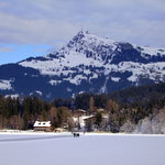 View across frozen Schwarzee lake to Kitzbuhel Horn