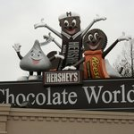 Hershey-branded characters welcome visitors to Chocolate World.