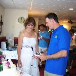 The Groom Cuts the Cake