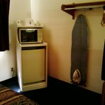 Fridge, microwave, and ironing board