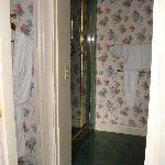  Shower &amp; bathroom area w/ robes.