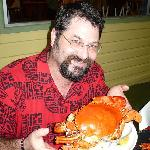 A happy diner about to enjoy a delicious mud crab.