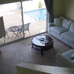 Our living room--with slider leading to pool and beach!
