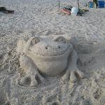 Cute frog someone made in the sand