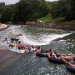  Tubers going over the dam to the rapids