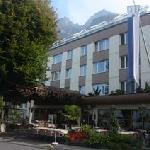 Front of hotel with mountains beyond
