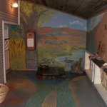 Coyote's corner kid's area with Jan Cook Mack painting on wall and floor.
