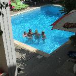 Happy people in the pool at Renia Apartments