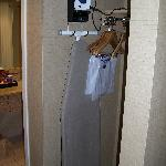 Iron and ironing board in closet area