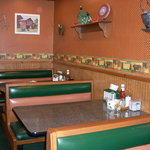 The booths in the dining room with country decor.