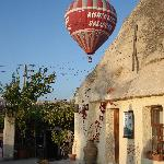 The cave rooms and terrace where breakfast is served and watch the balloons overhead!