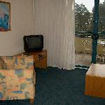 The lounge room had a single seater and a two seater with a TV and DVD player