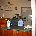  ms. annette at front desk  with a smile