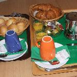 delicious bkfast served in rm- hot choc, coffee, bread, jams, butter, OJ