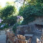 convivial outdoor fireplace and chairs