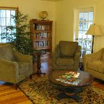 living room, with sunroom off to the right
