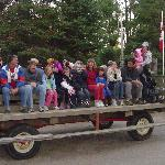 Kids and families on the wagon ride that toured the campground