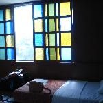 capiz style windows inside the room to cover the sun on the glass windows