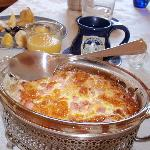 ham/egg souffle for breakfast served in vintage casserole dishes.