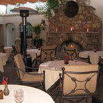 Delicias courtyard is perfect for romantic dining by the fireplace.