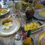 Typical Breakfast with poched eggs, fruit, juice, coffee, toast, etc.