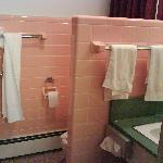  Pink tiles in the bathroom.