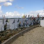Puja prayer flags line the seaside wall at Waterloo Temple in the Sea
