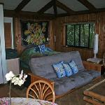 The blue cottage - sofa and bed beyond