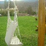 """Hanging"" chair facing the garden and the mountains"